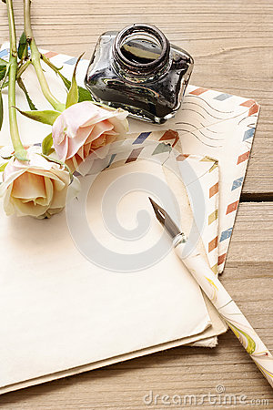 Vintage letters, roses and bottle of ink