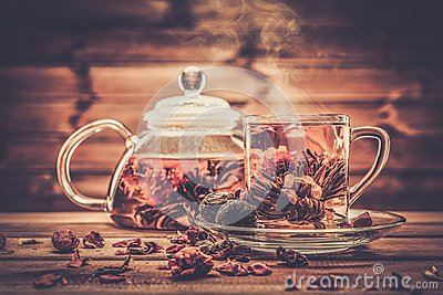 Glass teapot with blooming tea flower