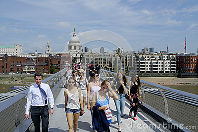 Tourists on the millennium bridge in london