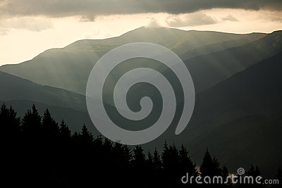 Mountain landscape, the sun rays through the clouds