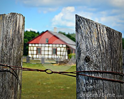 Fence Posts with Historic Building at Old World Wisconsin
