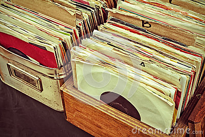 Retro styled image of vinyl lp records on a flee market