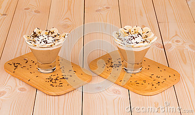 Fresh made Banana Milkshake on wooden background