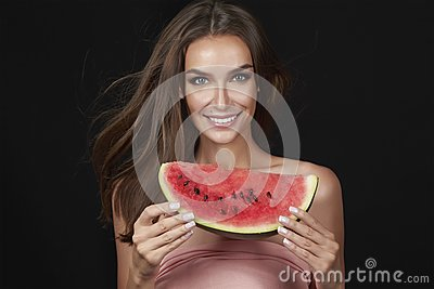 Beautiful brunette woman eating watermelon on a white background, healthy food, tasty food, organic diet, smile healthy, blac