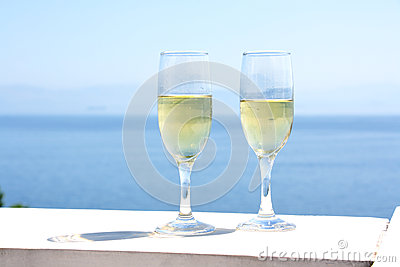 Champagne glasses with sea background