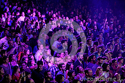 A view from above of people clapping in a concert at Razzmatazz discotheque