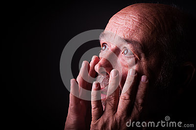 Old man looking frighten or scared