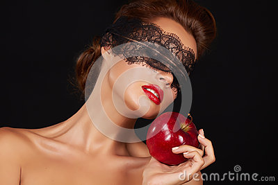 Beautiful sexy brunette woman with lace eating red apple healthy food, tasty food, organic diet, smile healthy, boac