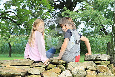 Kids on stone wall