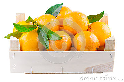 Orange fruits in a wooden box