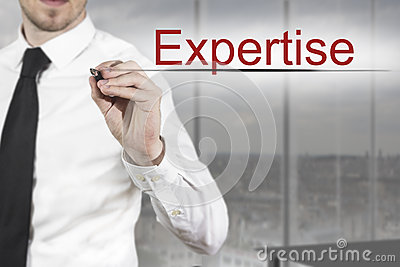 Businessman writing expertise in the air