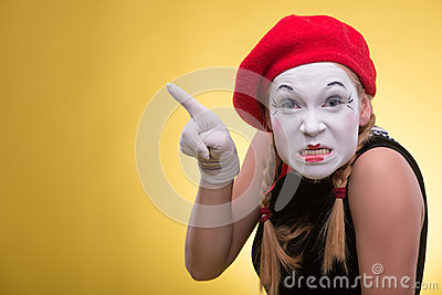 Portrait of female mime isolated on yellow