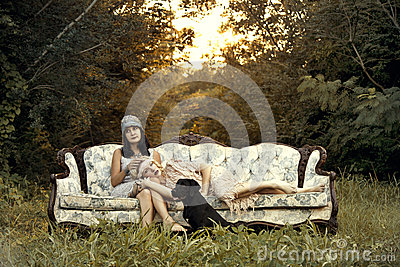 Women in twenties fashion on vintage couch