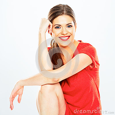 Portrait of smiling woman sitting against white background.