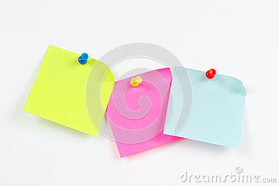 Three multi-colored stickers on white message board