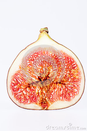 Fruit of sectioned fresh fig isolated on white background
