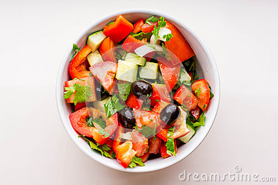 Fresh vegetable salad in white bowl