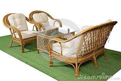 Set of rattan furniture on artificial grass isolated on white ba