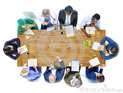 Group of Business People and Doctors in a Meeting