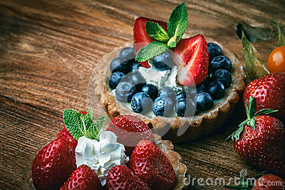 stock image of desserts on wooden table