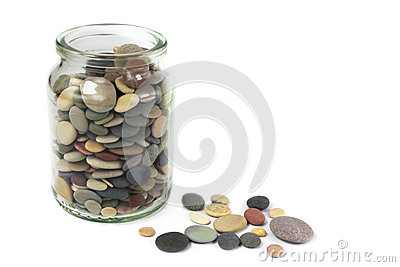 Pebbles or Beach stones in a glass jar