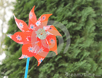 Red Pinwheel in a Garden