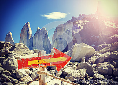 Vintage picture of wooden direction sign post on a mountain path