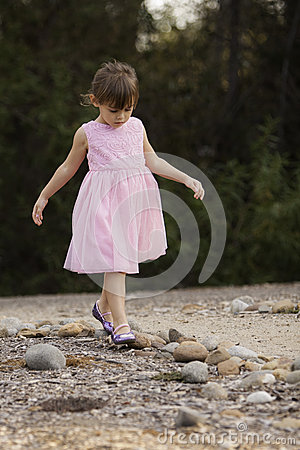 Pretty 3 1/2 year old Asian-Caucasian girl in pink dress