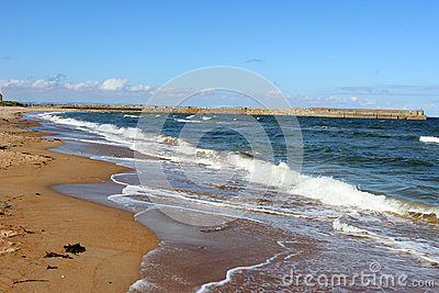 Waves breaking on sandy beach, St Andrews, Fife