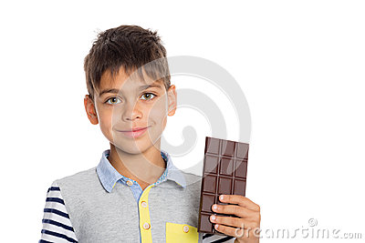 Little boy holding a chocolate