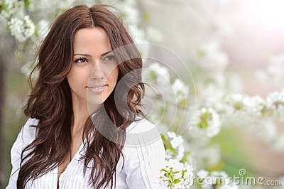 Spring beauty girl. Beautiful young woman in a summer park outdo