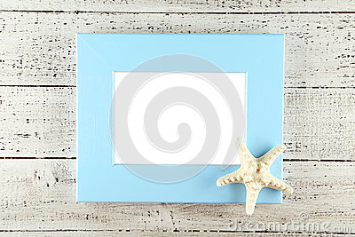 Wood frame on white wooden background.