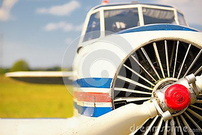 View on propeller on old russian airplane on green grass