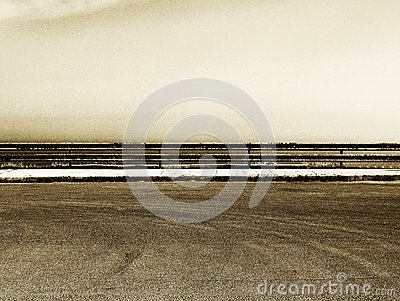 Empty parking with guardrail, grainy sepia hue