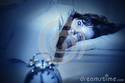 Woman in bed with eyes opened suffering insomnia and sleep disorder