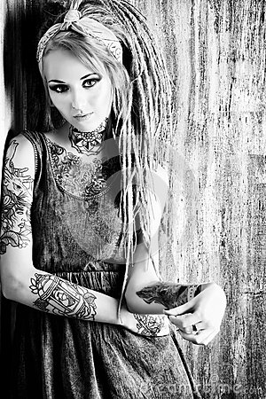 naked tattoo girl with dreads