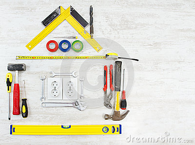 Tools shape of house, Home improving, repair concept. Wooden background
