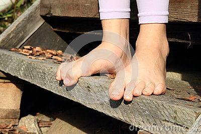 Bare feet on stair