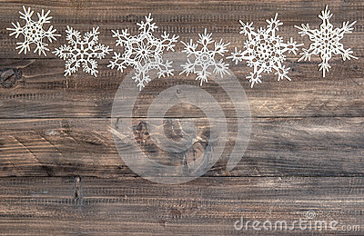 Snowflakes border over wooden background. christmas decoration