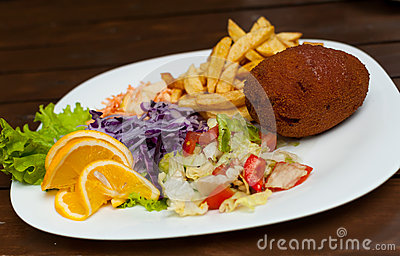 Kiev cutlet with salad