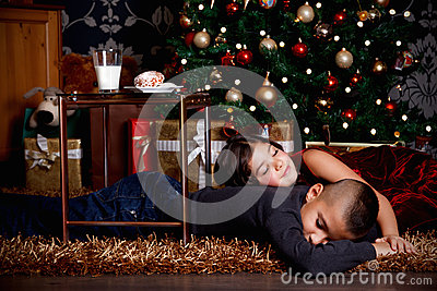 Cute kids waiting for Christmas gifts