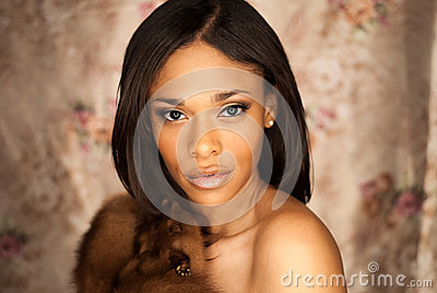 Sexy African American fashion model wearing a fox fur