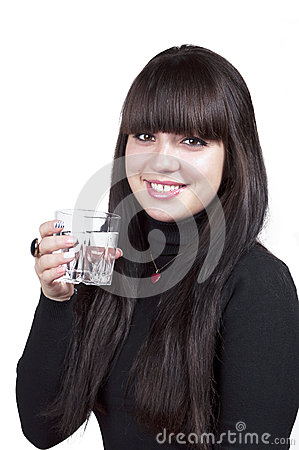 Brunette smiling girl with glass of water, isolated
