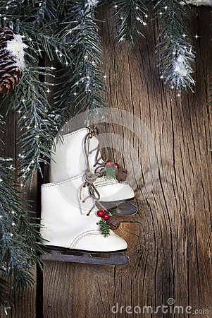 Ice Skates with Evergreen Boughs