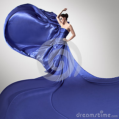 Young beautiful woman in fluttering blue dress.