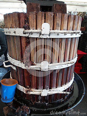 Extracting grape juice with old manual wine press