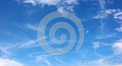 Soft white clouds against blue sky