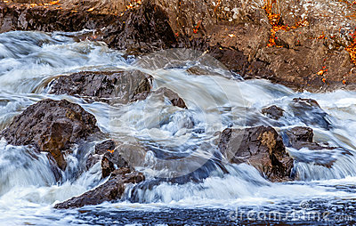Flowing Water over Rocks in Stream