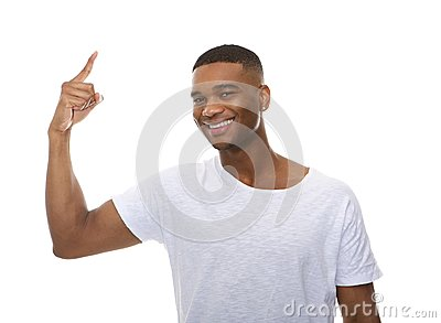 Close up portrait of a happy young man pointing finger