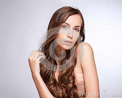 Fashion Model Girl Portrait with Long Blowing Hair. Glamour Beau